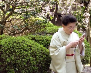 Texting at Okazaki Shrine, Kyoto.  April 2008.
