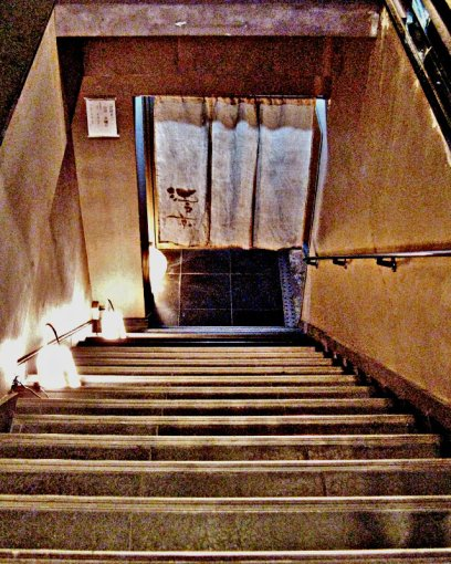 Down the stairs. . .