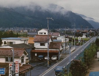Looking down Asaki's main road from atop the Middle School. Early Spring 1991.